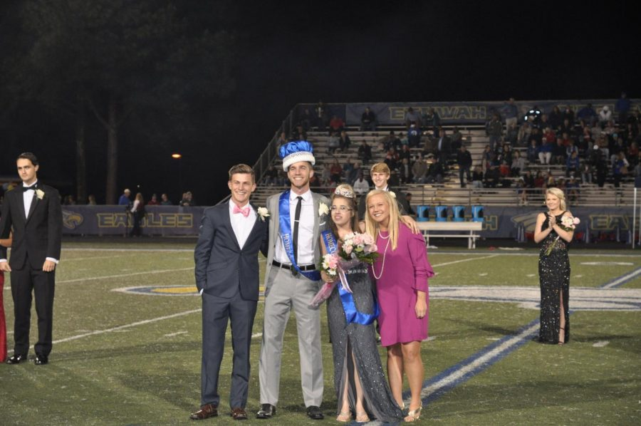 Former Homecoming King, Ryan Lavery, and former Homecoming Queen, Evan Arnold, crown this years king and queen, Nick Nagy and Sarah Dickman