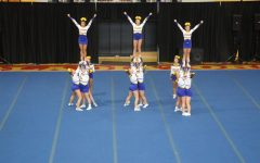 Behind- the- Scenes: Etowah comp cheer