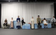 """On Jan. 22, the Etowah drama department performed """"The Anatomy of Grey.""""  In the image above, cast and crew from the Etowah High school production of """"TheAnatomy of Grey,"""" stand on stage pre-show listening toCharlotteForrest, the drama teacher.  """"During thefall semester, it was very unclear whether we would get to do the show at all. Even though it was a tough time, we still got to be together and work on something we care about. They are hard workers, intelligent students, and inventive artists,""""Forrest said."""